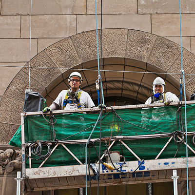 two men on scaffolding