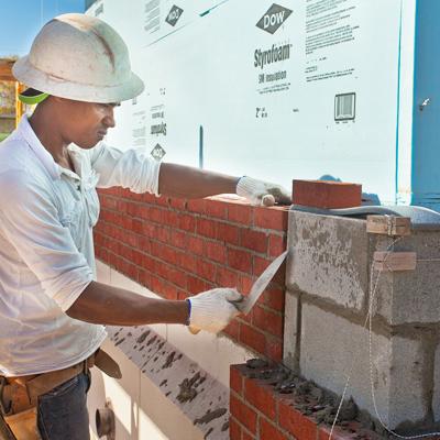 brick layer fixing bricks